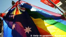 A protester shows his colours during a gay rights march through Sydney to the ruling Labor Party's conference to stage a mass 'illegal wedding' stunt on August 1, 2009. The national Labor conference voted to develop a system for the registration and recognition of same-sex relationships, after gay rights advocates failed to gather enough numbers for a resolution to legalise gay marriage. Australian Prime Minister Kevin Rudd won the 2007 election on a platform that supported the former conservative government's legal definition of marriage as a union between a man and a woman. AFP PHOTO/Torsten BLACKWOOD (Photo credit should read TORSTEN BLACKWOOD/AFP/Getty Images)