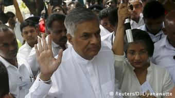 Sri Lanka's Prime Minister Ranil Wickremesinghe (C) waves as he arrives with his wife Maithree Wickramasinghe at a polling station during the general election in Colombo August 17, 2015 (Photo: REUTERS/Dinuka Liyanawatte)