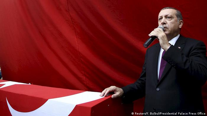 Turkish President Recep Tayyip Erdogan at soldier Ahmet Camur's funeral