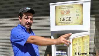 Issam Massaoudi, an unemployed Moroccan immigrant, poses in front of the Solidarity Fridge in Galdakao (Photo: Lauren Frayer)