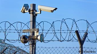 CCTV cameras above a barbed wire fence (Colourbox)