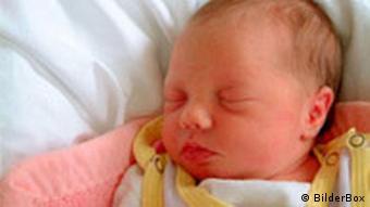 Infant in crib.