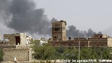 Smoke billows following air-strikes by the Saudi-led coalition on a weapons depot at a military airport, currently controlled by Yemeni Shiite Huthi rebels, in the capital Sanaa on August 20, 2015. Yemen has been wracked by conflict since March, when the Saudi-led coalition launched air strikes against the rebels as they advanced on the main southern city of Aden, after seizing the capital in September. AFP PHOTO / MOHAMMED HUWAIS (Photo credit should read MOHAMMED HUWAIS/AFP/Getty Images)