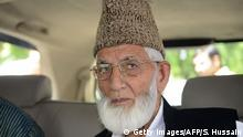 Kashmiri separatist leader and chairman of Kashmir's All Parties Hurriyat Conference (APHC), Syed Ali Shah Geelani looks on as he arrives at the Pakistan embassy in the capital New Delhi on August 19, 2014. India on August 18 cancelled talks with Pakistan scheduled for next week, angrily berating Islamabad over a meeting between Pakistan's high commissioner and Kashmiri separatists. AFP PHOTO / SAJJAD HUSSAIN (Photo credit should read SAJJAD HUSSAIN/AFP/Getty Images)