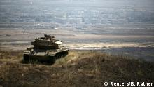 The Syrian area of Quneitra is seen in the background as an out-of-commission Israeli tank parks on a hill, near the ceasefire line between Israel and Syria, in the Israeli-occupied Golan Heights, August 21, 2015. An Israeli air strike on the Syrian Golan Heights killed at least four Palestinian militants responsible for Thursday's rocket fire on an Israeli village, an Israeli defense official said on Friday. REUTERS/Baz Ratner