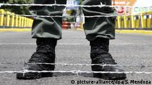 Soldier's boots pictured at a border between Colombia and Venezuela (picture-alliance/dpa/S. Mendoza)