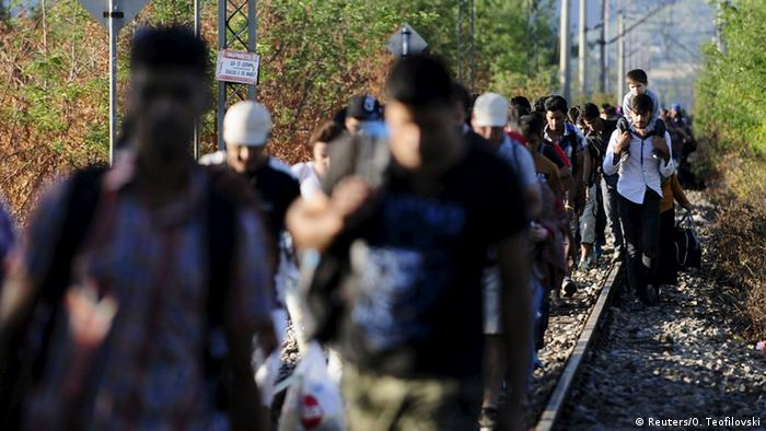 Migrants cross into Macedonia near Gevgelijia, from Greece's border with Macedonia, August 23, 2015.