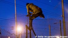 04.08.2015+++ A migrant climbs over a fence into the Channel Tunnel site in Frethun, northern France, on August 5, 2015. The European Commission offered August 4 to help France and Britain deal with the migrant crisis at the Channel Tunnel, as police on both sides braced for new attempts at the crossing. AFP PHOTO / PHILIPPE HUGUEN (Photo credit should read PHILIPPE HUGUEN/AFP/Getty Images)