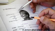 BdT Erstaufnahmeeinrichtung Lernheft Lesen Schreiben Angela Merkel Porträt