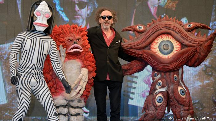Director Tim Burton poses with monsters