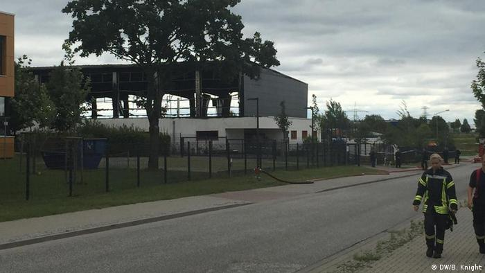 The burnt-out sports center in Nauen
