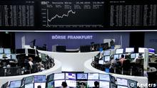 25.08.2015 *** Traders are pictured at their desks in front of the DAX board at the stock exchange in Frankfurt, Germany, August 25, 2015. REUTERS/Staff/remote