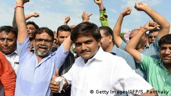 Hardik Patel (C), an organiser of the Patidar community, gathers with group members for a rally demanding Other Backward Class (OBC) status in Ahmedabad on August 23, 2015 (Photo: SAM PANTHAKY/AFP/Getty Images)