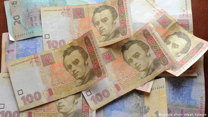 Украинские гривны в бумажных купюрах разного достоинства