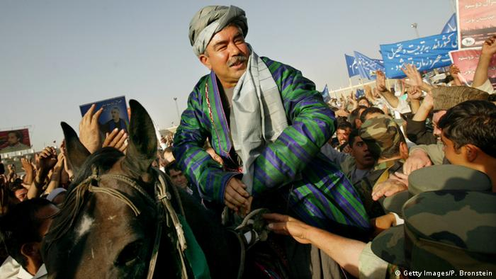 General Abdul Rashid Dostum sits on a horse during his final campaign rally October 6, 2004 at Kabul stadium in Kabul, Afghanistan (Photo by Paula Bronstein/Getty Images)