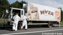 27.08.2015 *** Forensic police officers inspect a parked truck in which up to 50 migrants were found dead, on a motorway near Parndorf, Austria August 27, 2015. As many as 50 refugees were found dead in a parked lorry in eastern Austria near the Hungarian border on Thursday. Police made the grisly discovery in the 7.5-tonne lorry stopped on the A4 motorway near the town of Parndorf, apparently since Wednesday. Police could not put an exact figure on the number of victims, whose bodies had begun to decompose. REUTERS/Heinz-Peter Bader TPX IMAGES OF THE DAY