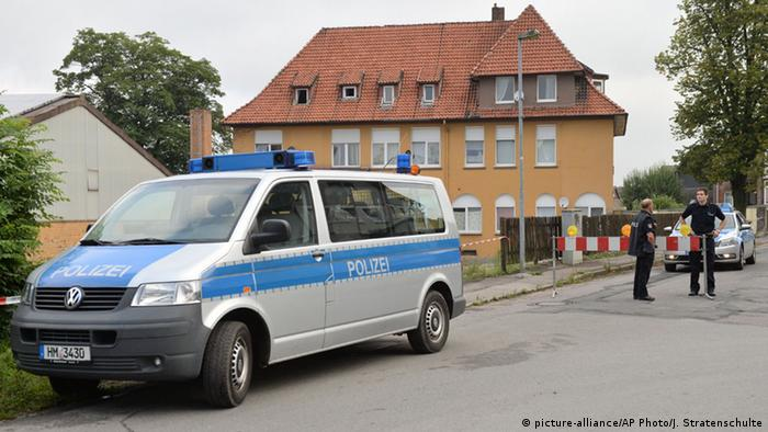 A police car stands in front of a home for asylum seekers in Salzhemmendorf,