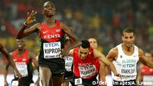 BEIJING, CHINA - AUGUST 30: Asbel Kiprop of Kenya crosses the finish line to win gold in the Men's 1500 metres final ahead of Abdalaati Iguider of Morocco during day nine of the 15th IAAF World Athletics Championships Beijing 2015 at Beijing National Stadium on August 30, 2015 in Beijing, China. (Photo by Andy Lyons/Getty Images)