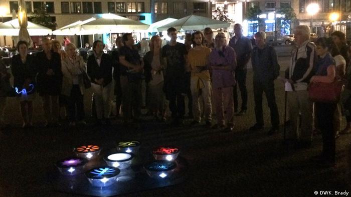 People gather around the Peace Lights on Gendarmenmarkt in Berlin