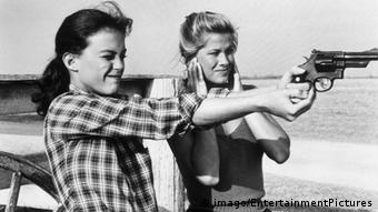 Two women practice shooting