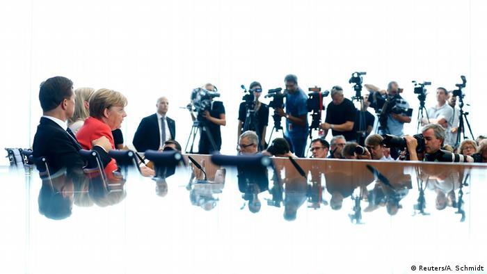 Opinion: Merkel steps up