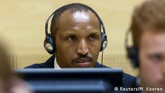 Bosco Ntaganda listens to ICC proceedings via headphones