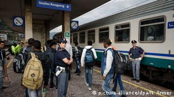 Police and migrants at an Italian train station