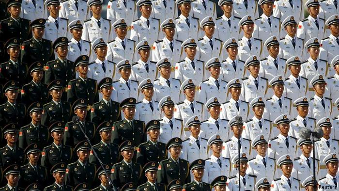Members of military choir stand in formation at the Tiananmen Square before a military parade to mark the 70th anniversary of the end of World War Two, in Beijing, China September 3, 2015.