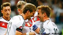 Germany's Thomas Mueller celebrates with Mario Goetze (R) after he scored a goal during their Euro 2016 qualification match against Poland in Frankfurt, Germany, September 4, 2015. REUTERS/Kai Pfaffenbach