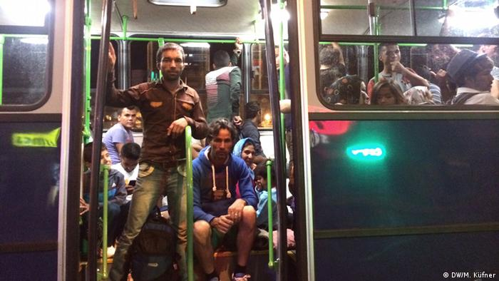 Bus with migrants at Keleti train station.