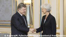 6.9.2015 *** Ukrainian President Petro Poroshenko and International Monetary Fund (IMF) Managing Director Christine Lagarde shake hands during their meeting in Kiev, Ukraine, in this September 6, 2015 handout photo provided by the Ukrainian Presidential Press Service. REUTERS/Mykhailo Markiv/Ukrainian Presidential Press Service/Handout via Reuters ATTENTION EDITORS - THIS IMAGE HAS BEEN SUPPLIED BY A THIRD PARTY. IT IS DISTRIBUTED, EXACTLY AS RECEIVED BY REUTERS, AS A SERVICE TO CLIENTS. REUTERS IS UNABLE TO INDEPENDENTLY VERIFY THE AUTHENTICITY, CONTENT, LOCATION OR DATE OF THIS IMAGE. FOR EDITORIAL USE ONLY. NOT FOR SALE FOR MARKETING OR ADVERTISING CAMPAIGNS.