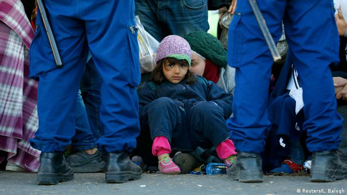 Refugees in Hungary are guarded by police
