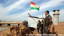 14.01.2015 **** (150114) -- KIRKUK, Jan. 14, 2015 () -- A soldier of Kurdish Peshmerga forces looks far into the area controlled by Islamic State militants in the Khalid's Office, an area 25 km west of Kirkuk, northern Iraq, on Jan. 14, 2015. (/Ako Zangna)