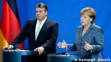 07.09.2015*** German Chancellor Angela Merkel gestures next to Economy Minster Sigmar Gabriel (L) during a press conference at the Chancellery in Berlin, Germany September 7, 2015. Merkel and her deputy Gabriel discuss results of last night's coalition meeting on how to handle the increasing influx of refugees. REUTERS/Fabrizio Bensch