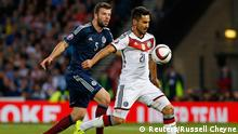 Football - Scotland v Germany - UEFA Euro 2016 Qualifying Group D - Hampden Park, Glasgow, Scotland - 7/9/15 Germany's IIkay Gundogan in action with Scotland's Grant Hanley Reuters / Russell Cheyne Livepic EDITORIAL USE ONLY.