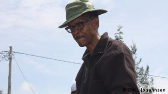 President Kagame wearing a hat and looking pensive