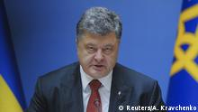 Ukrainian President Petro Poroshenko addresses a cabinet meeting in Kiev, Ukraine, September 8, 2015. Ukraine still faces the threat of a full-scale Russian military attack despite several days of relative calm on the front-lines of the east where government forces confront Russian-backed separatists, Poroshenko said on Tuesday. REUTERS/Andrew Kravchenko/Pool