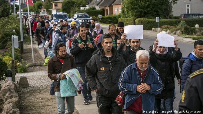Middle Eastern migrants, who came from Germany by ferry and train Sunday night, and are walking from Rodby in southern Denmark towards Sweden on Monday Sept. 7, 2015