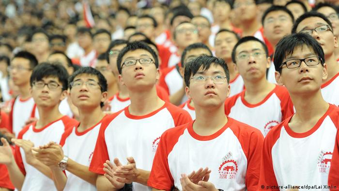 Chinese students, most of whom are nearsighted and wear glasses, attend the opening ceremony of the new semester for freshmen at Shanghai Jiao Tong University in Shanghai, China, 8 September 2013.