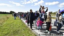 A large group of migrants, mainly from Syria, walk towards the north on a highway in Denmark September 7, 2015. The migrants intend to reach Sweden and seek asylum there. REUTERS/Bax Lindhardt/Scanpix Denmark ATTENTION EDITORS - THIS IMAGE WAS PROVIDED BY A THIRD PARTY. IT IS DISTRIBUTED EXACTLY AS RECEIVED BY REUTERS, AS A SERVICE TO CLIENTS. FOR EDITORIAL USE ONLY. NOT FOR SALE FOR MARKETING OR ADVERTISING CAMPAIGNS. DENMARK OUT. NO COMMERCIAL OR EDITORIAL SALES IN DENMARK. NO COMMERCIAL SALES.