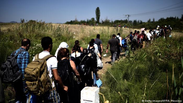 Flüchtlinge (Foto: ARIS MESSINIS/AFP/Getty Images)