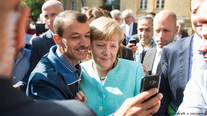 Merkel with refugees in Berlin