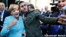 10.09.2015 ***** A migrant takes a selfie with German Chancellor Angela Merkel outside a refugee camp near the Federal Office for Migration and Refugees after registration at Berlin's Spandau district, Germany September 10, 2015. REUTERS/Fabrizio Bensch TPX IMAGES OF THE DAY