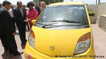 India's giant Tata group conglomerate Chairman Ratan Tata (2 L) shakes hands with South African International Relations Minister Maite Nkoane-Mashabane as she and her fellow colleague minister Robert Davies (R) inspect the world's cheapest car, the Tata Nano, in Mumbai on June 3, 2010 (Photo: INDRANIL MUKHERJEE/AFP/Getty Images)