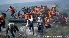 10.09.2015 **** Refugees and migrants arrive on a dinghy on the Greek island of Lesbos, September 10, 2015. Most of the people flooding into Europe are refugees fleeing violence and persecution in their home countries who have a legal right to seek asylum, the United Nations said on Tuesday. REUTERS/Dimitris Michalakis