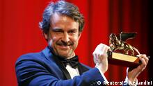 Director Lorenzo Vigas holds the Golden Lion prize for his movie Desde Alla (From Afar) during the award ceremony at the 72nd Venice Film Festival, northern Italy September 12, 2015. REUTERS/Stefano Rellandini