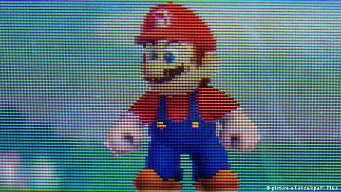 Die Hauptfigur des Videospiels Super Mario ist auf einem Nintendo 3DS zu sehen, fotografiert am 08.09.2015 in Sieversdorf (Brandenburg), Foto: Patrick Pleul/dpa