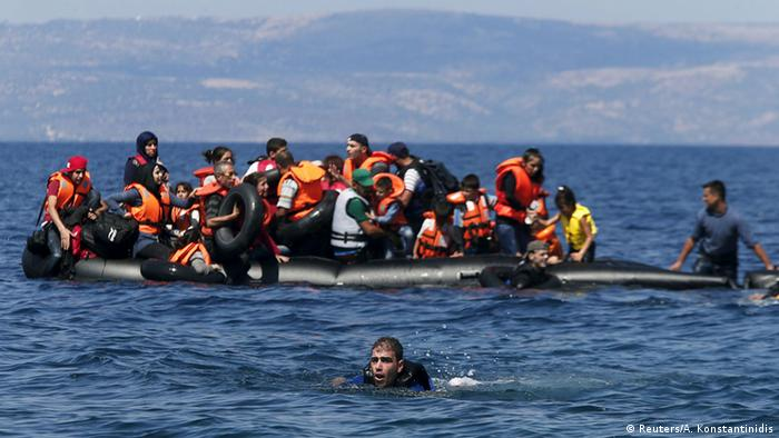 Refugee dinghy deflating, one refugee swimming for shore REUTERS/Alkis Konstantinidis