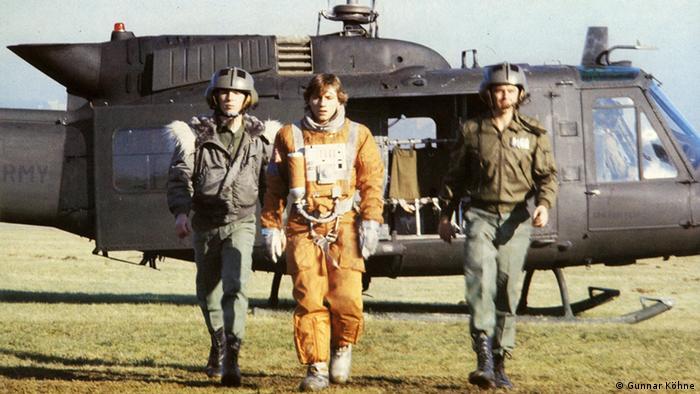امریش سرچشمه کشتی نوح را در سال ۱۹۸۴ در یکی از کارخانههای قدیمی تولید ماشینهای لباسشویی که تعطیل شده بود، ساخت. این فیلم پرهیجان عملیتخیلی درباره دو فضانورد است که ارتش آمریکا از وجود آنها برای مقاصد جنگی سوءاستفاده میکند. نمایی از سرچشمه کشتی نوح.
