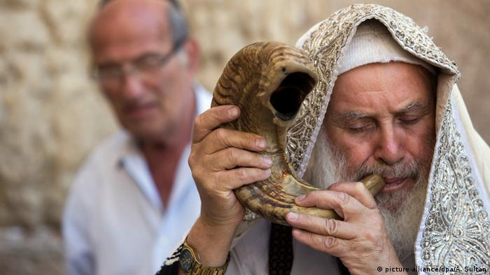 An Orthodox Jew blows the shofar, a trumpet made of ram's horn